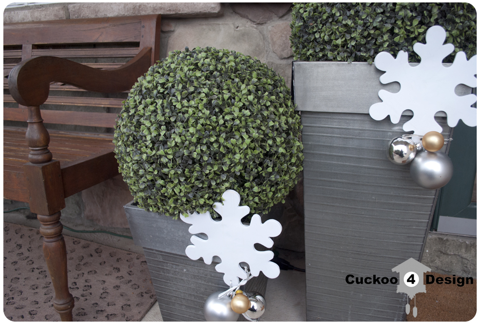 Silver Christmas ornaments with white craft snowflake and boxwoods