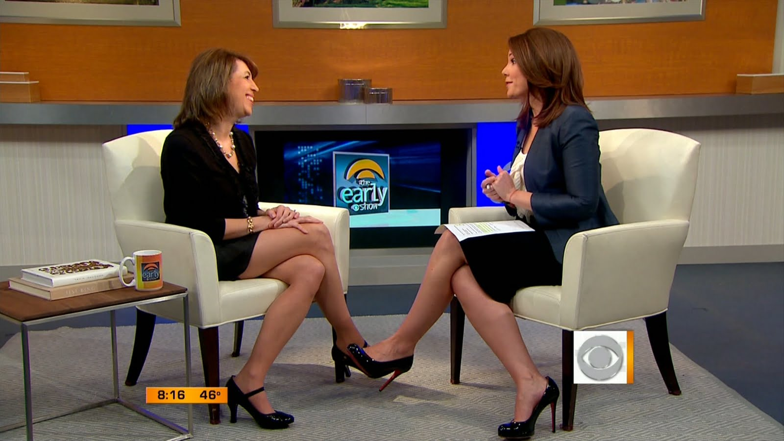 Erica Hill's Feet http://www.legcross.com/2011/04/erica-hill-on-cbs-early-show.html