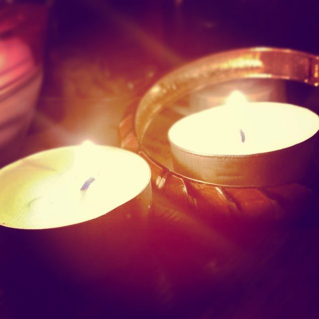 Two candles and gold bracelet