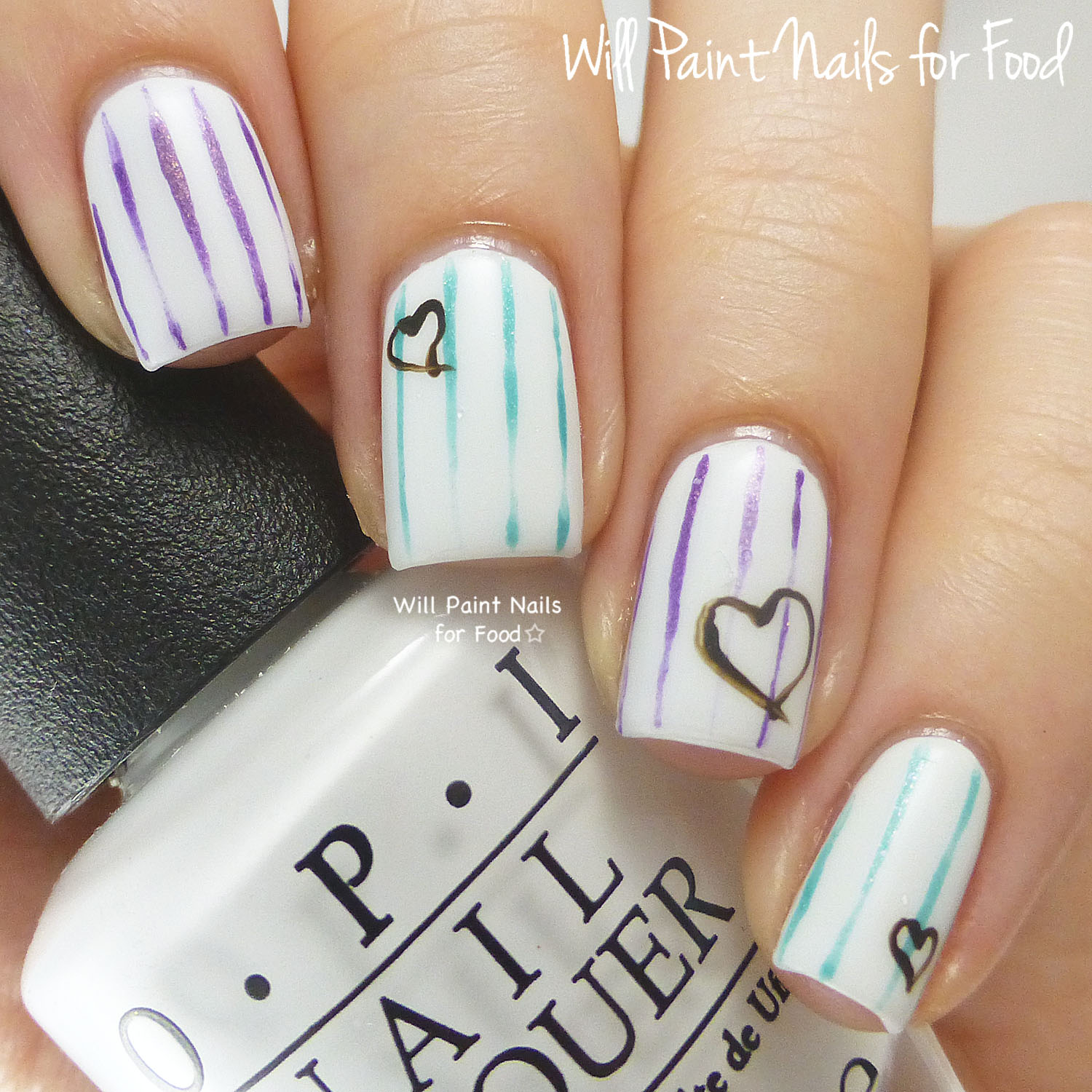 Pinstripes and hearts nail art