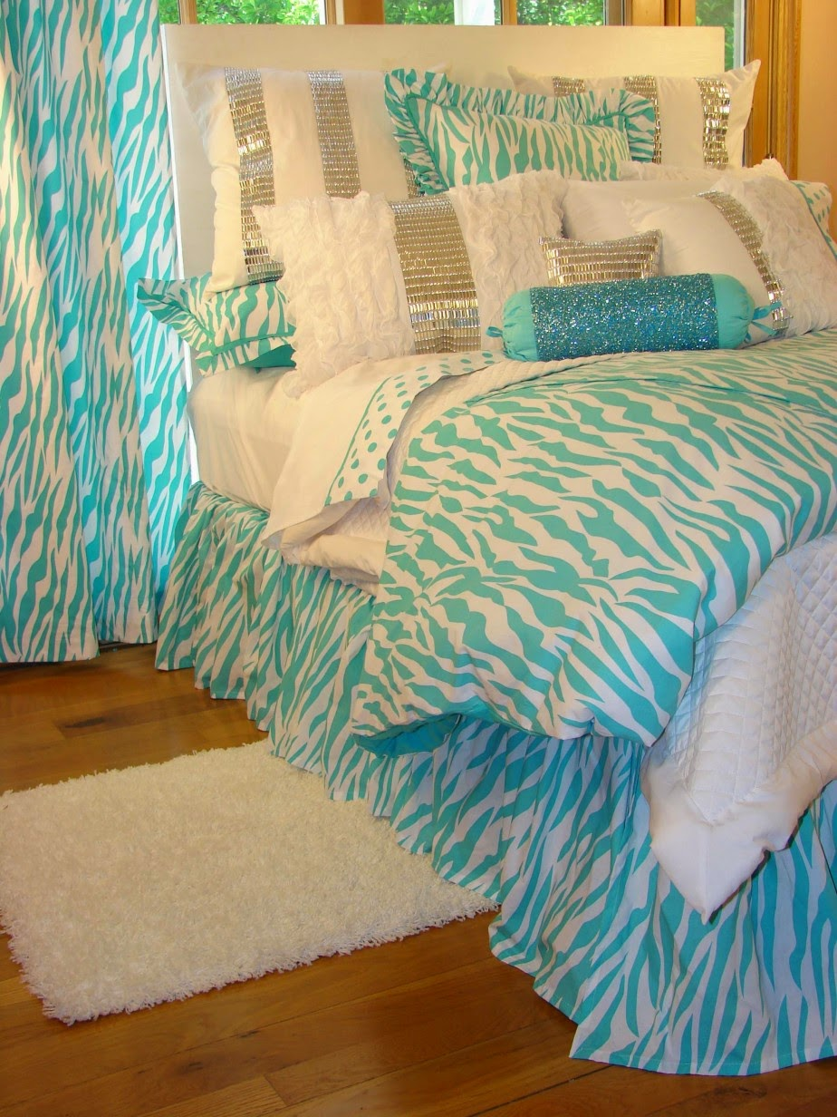 Beautiful enticing floral pattern turquoise bed sheet in casual white  bedroom with traditional rattan chair and basket fancy bed sheet. Beautiful enticing floral pattern turquoise bed sheet in casual