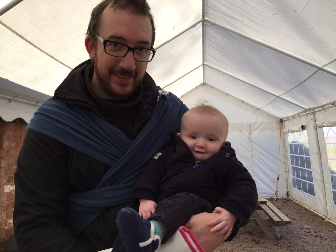 Stopping in the tea tent to feed the little man