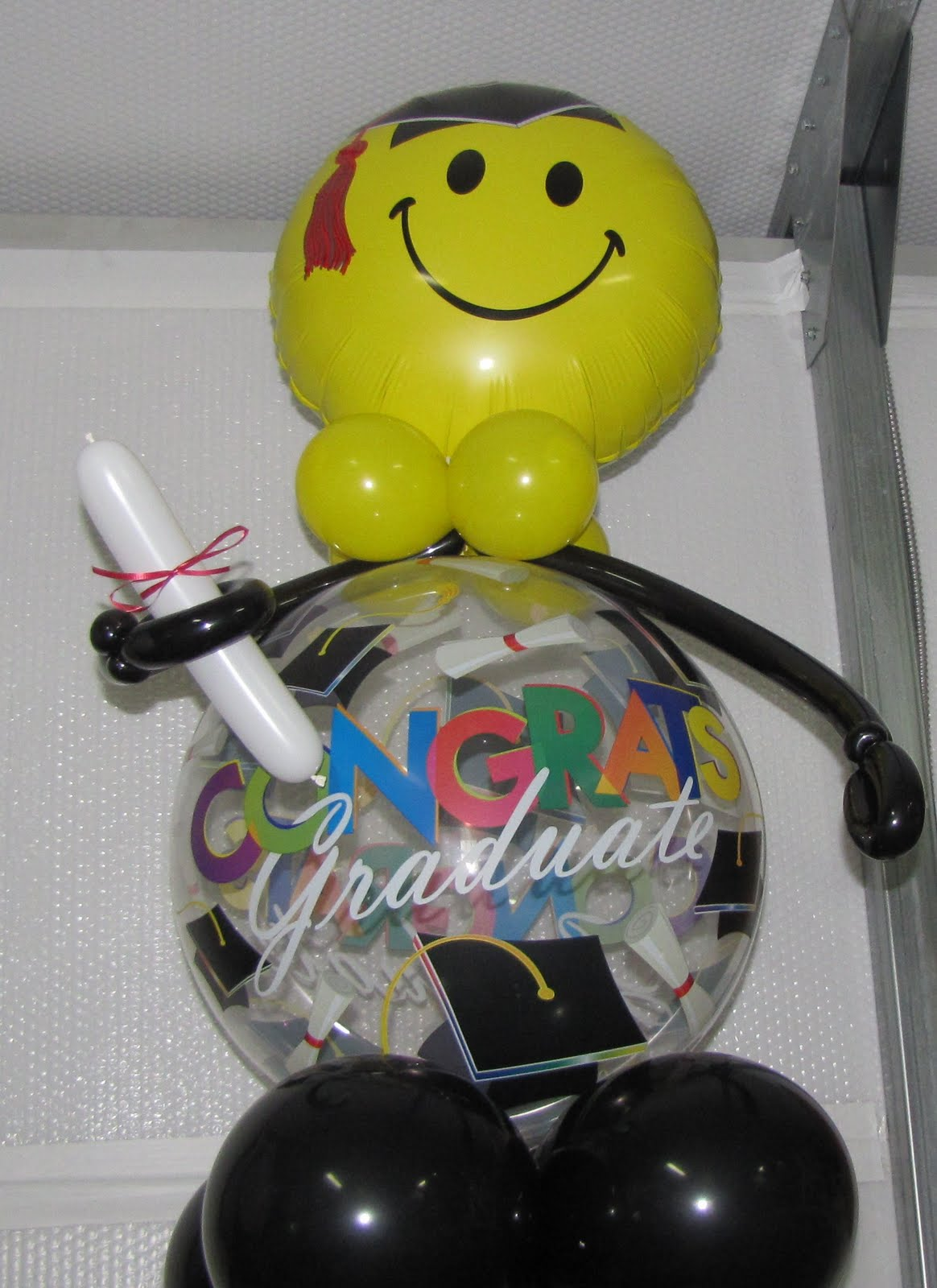 Party people event decorating company may 2011 for Balloon decoration graduation
