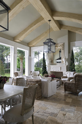 a cozy lounge and dining area open to the garden have white accent and rattan furniture