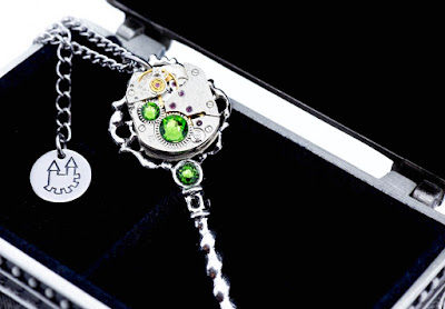 http://www.myclockworkcastle.co.uk/product/ornate-bejewelled-clockwork-key-pendant