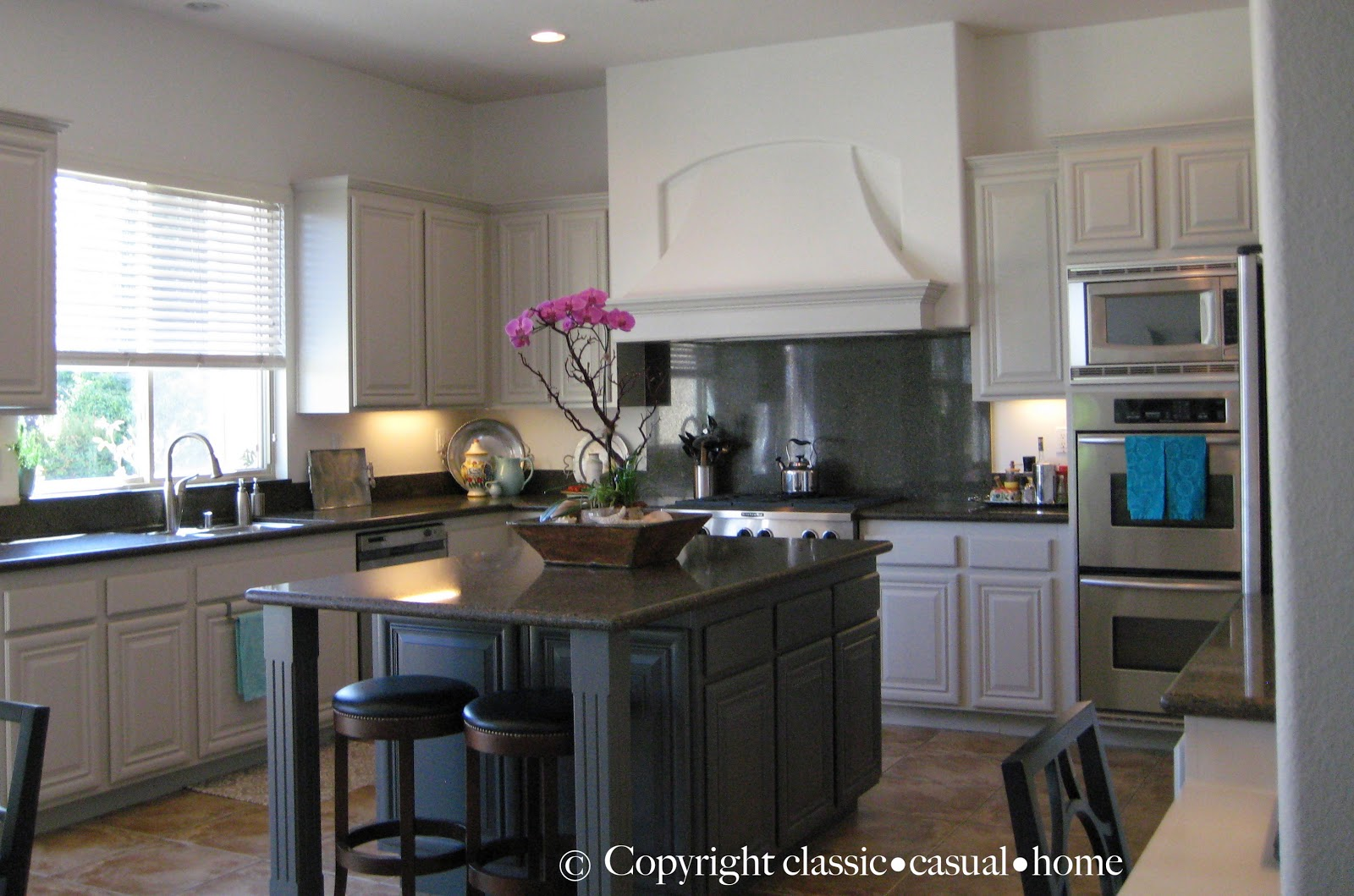 Classic casual home painted kitchen cabinets before for Cabinets before and after