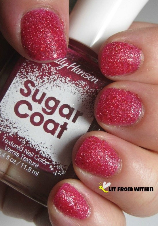 Sally Hansen Sugar Coat in Pink Sprinkle - a fun, bright, lightly sparkly pinky-red