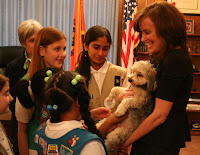 GSNC Womens History Month Blog - Kathleen Rice with Girl Scouts and Her Dog