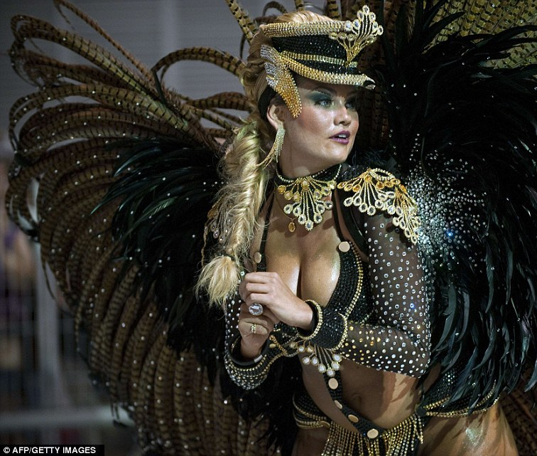 Got rhythm: a queen of the drums of the Rosas de Ouro samba school performs during the first night of Sao Paulo's Carnival parades.