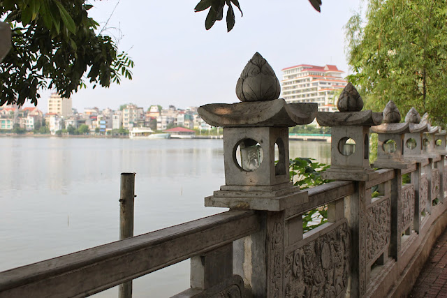 Enjoying the lake view and lotus lamp stand at the oldest pagoda of Tran Quoc Pagoda in Hanoi, Vietnam