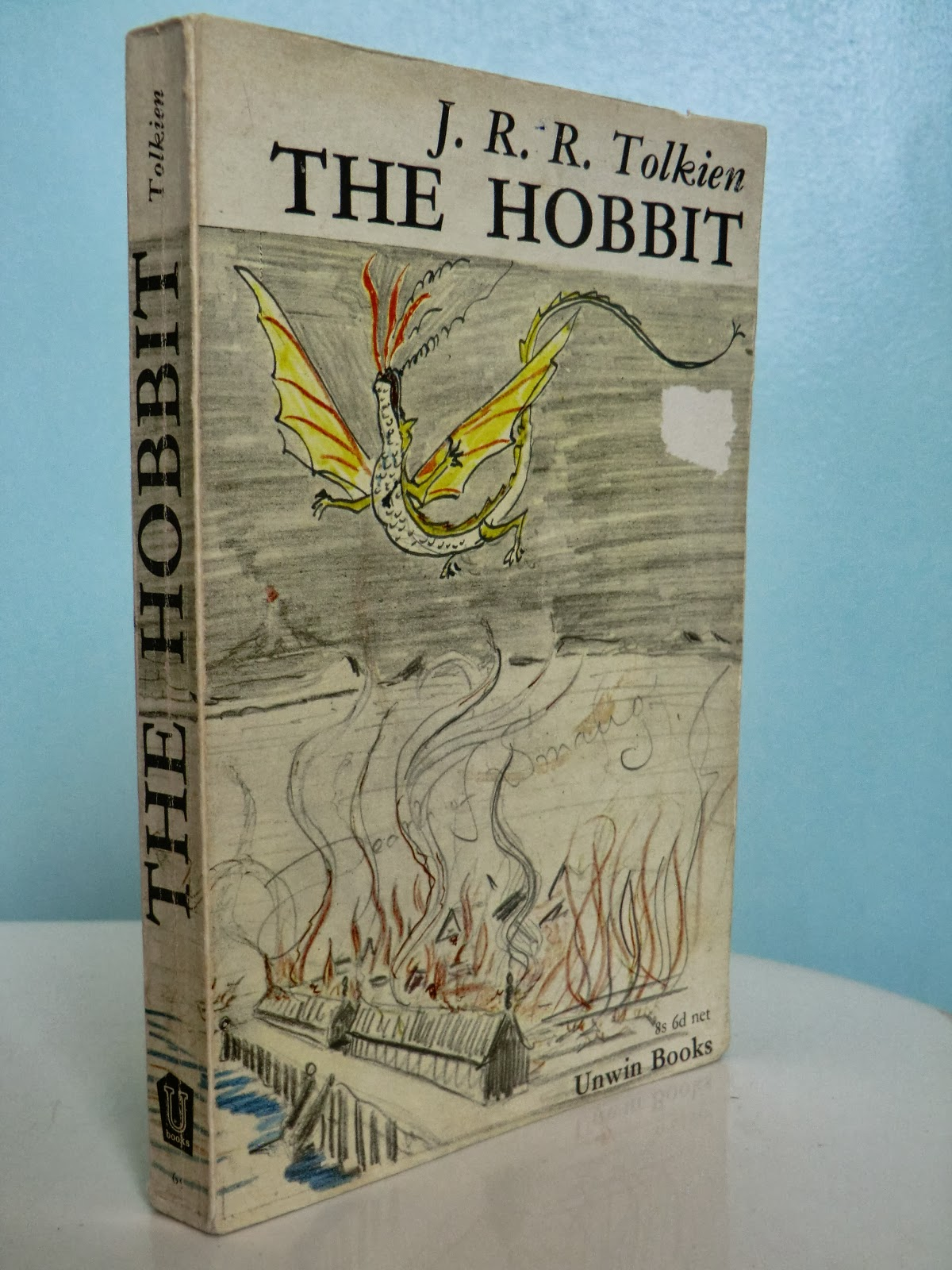 The Hobbit Old Book Cover ~ An antique books guide the hobbit j r tolkien s most