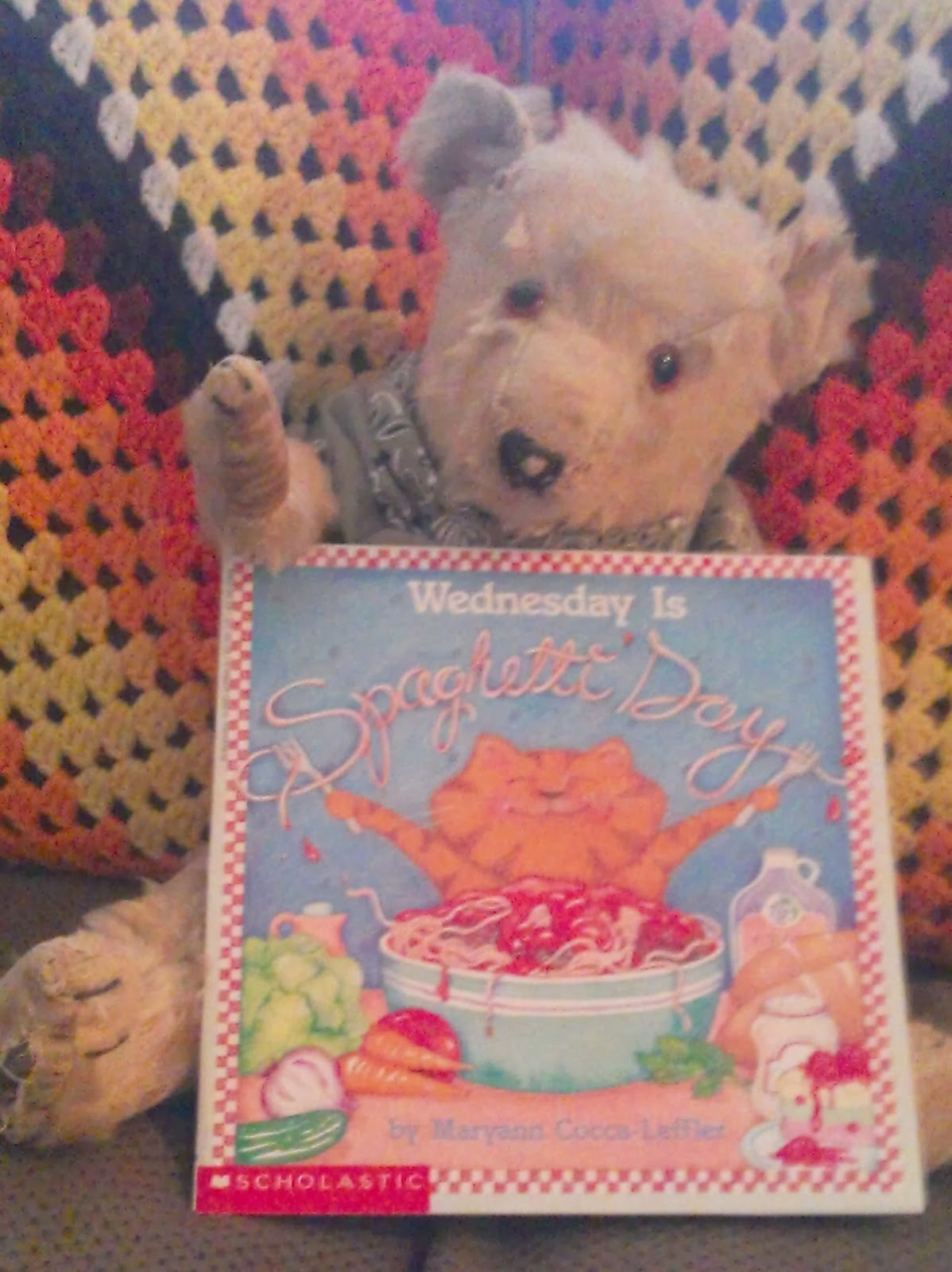 teddy bear holding picture book