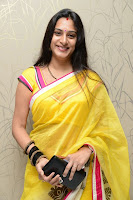 Surekha Vani Yellow Saree Hot photos at Yevadu movie Press Meet14