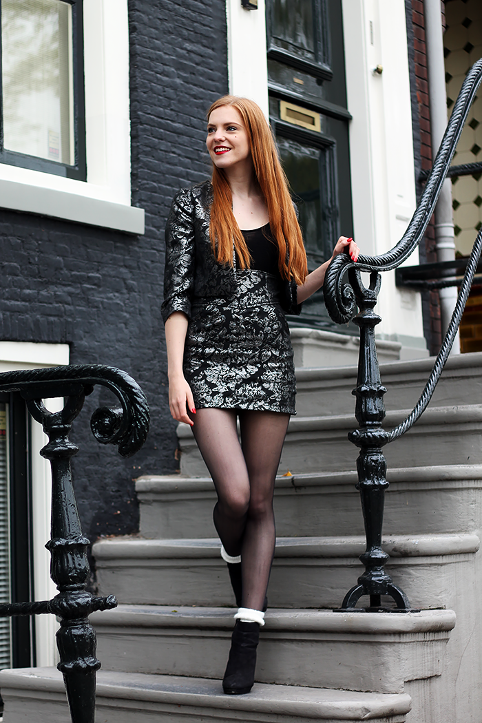 Fashion blogger outfit with a baroque co-ord suit and knitted socks in ankle boots. Red hair.