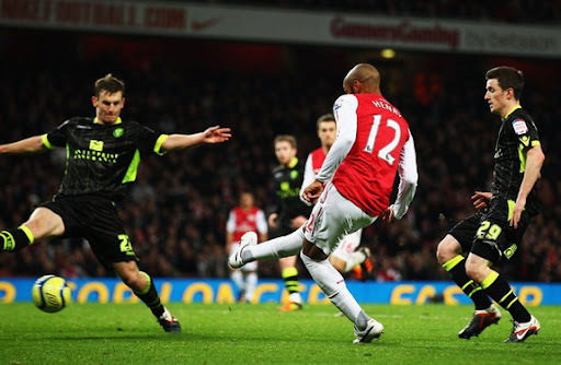 Thierry Henry shoots to score the winner for Arsenal against Leeds in the FA Cup