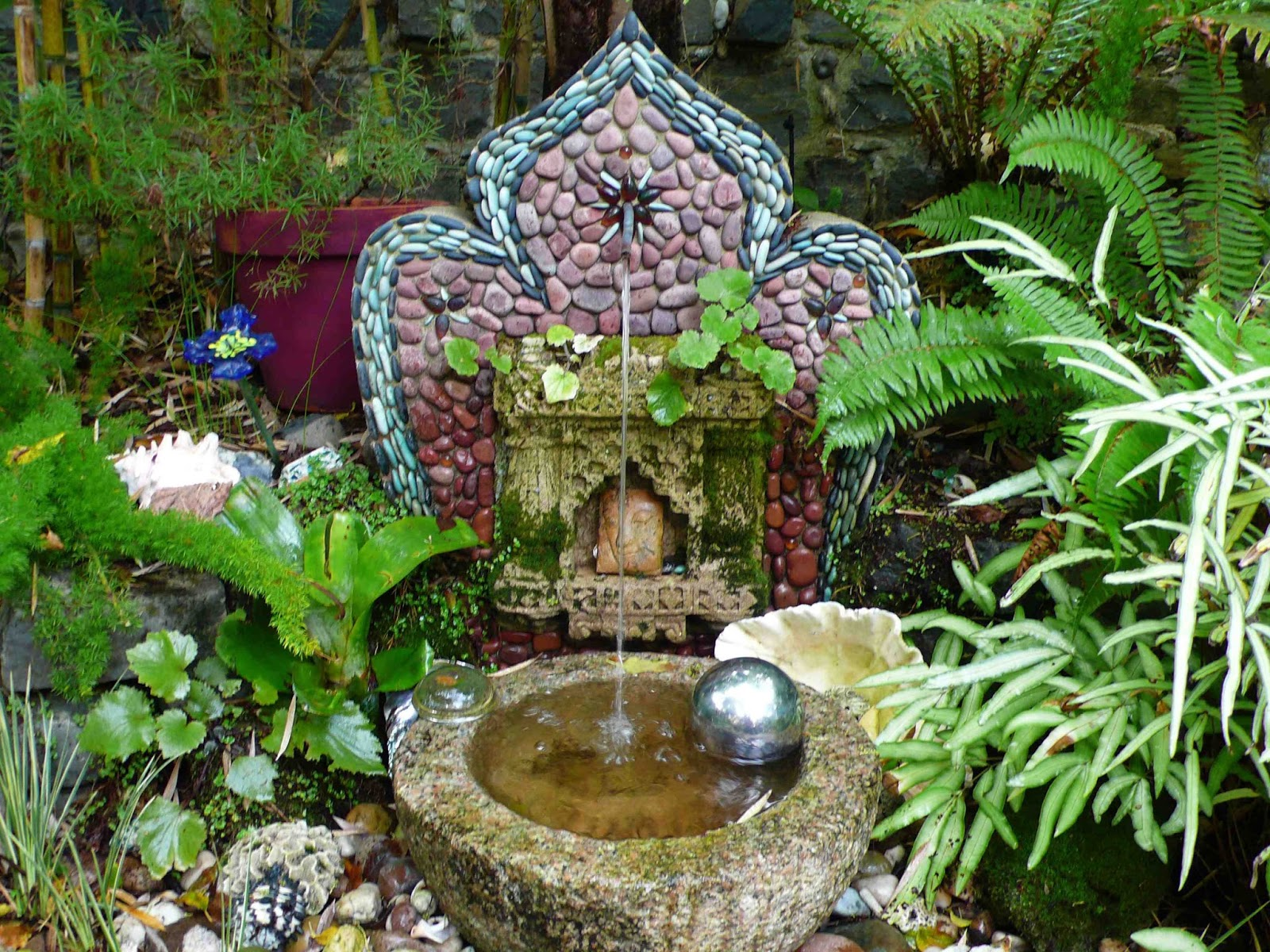 A Small Free Standing Fountain In The Smith/Garret Garden In San Francisco
