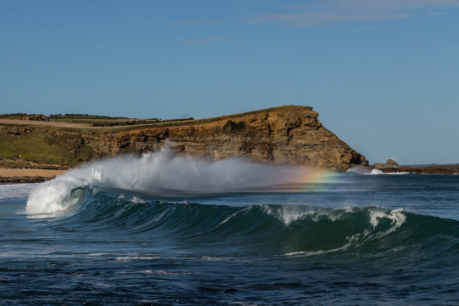 rainbow in breaking wave