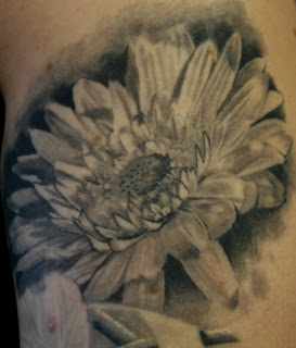 abstract daisy tattoos