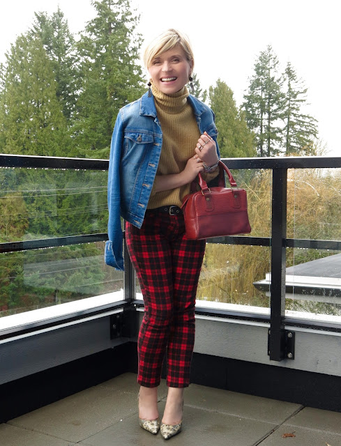 styling red plaid skinnies with a camel turtleneck, animal-print pumps, and a denim jacket