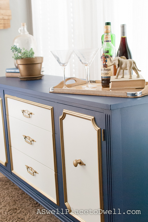 Furniture Makeover.  Navy blue, white and gold credenza from www.aswellplacetodwell.com