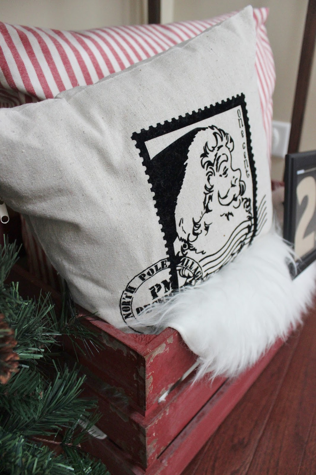 Holiday Decor: Rustic Crate Dressed Up with Santa Pillow and Faux Sheepskin Rug
