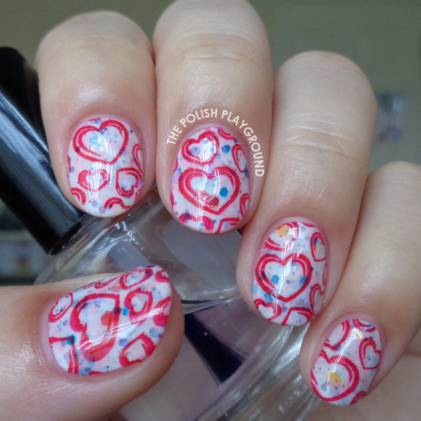 Double Stamped Pink and Red Hearts Valentine's Day Stamping Nail Art