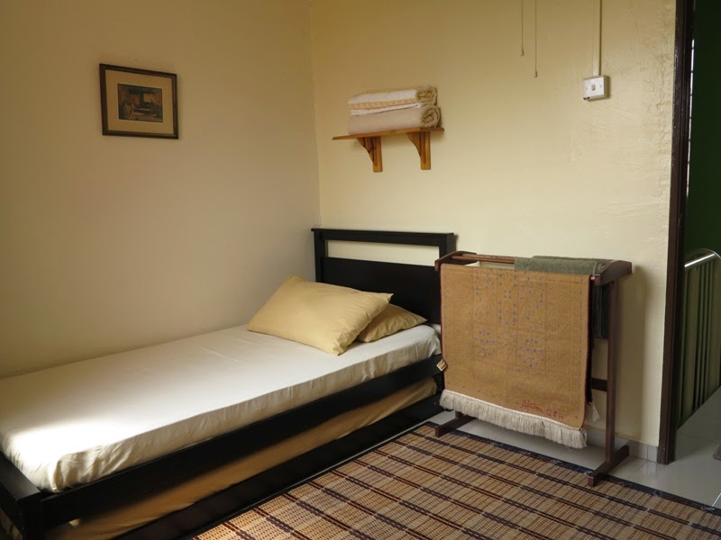 Photo 7: Room 3 - 2 single beds, push-pull bed, fan only