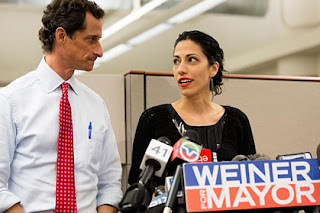 Huma Abedin, alongside her husband, New York mayoral candidate Anthony Weiner, speaks during a news conference at the Gay Men's Health Crisis headquarters, Tuesday, July 23, 2013, in New York.  John Minchillo/AP