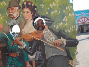 """In Classical Vienna  a """"Violin Shoot"""" at Prater.Recognize the face ?"""