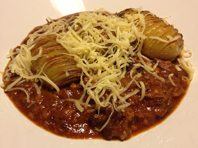 chilli with hasselback potatoes and grated cheese