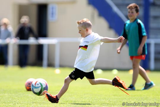 Liam Doran, 6, Beachlands, Auckland, kids play at half-time - Birkenhead beat Western Springs 1-0 in the final of the Napier City Rovers under-19 football tournament at Park Island, Napier. photograph