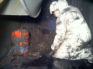 Industrial cleaning of residue from industrial exhaust fan.
