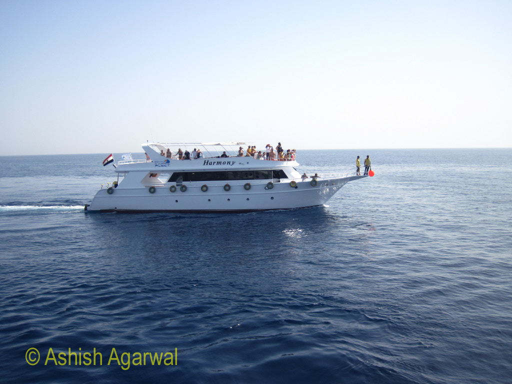 Small ship heading towars the coral formations off Sharm el Sheikh in the Red Sea in Egypt
