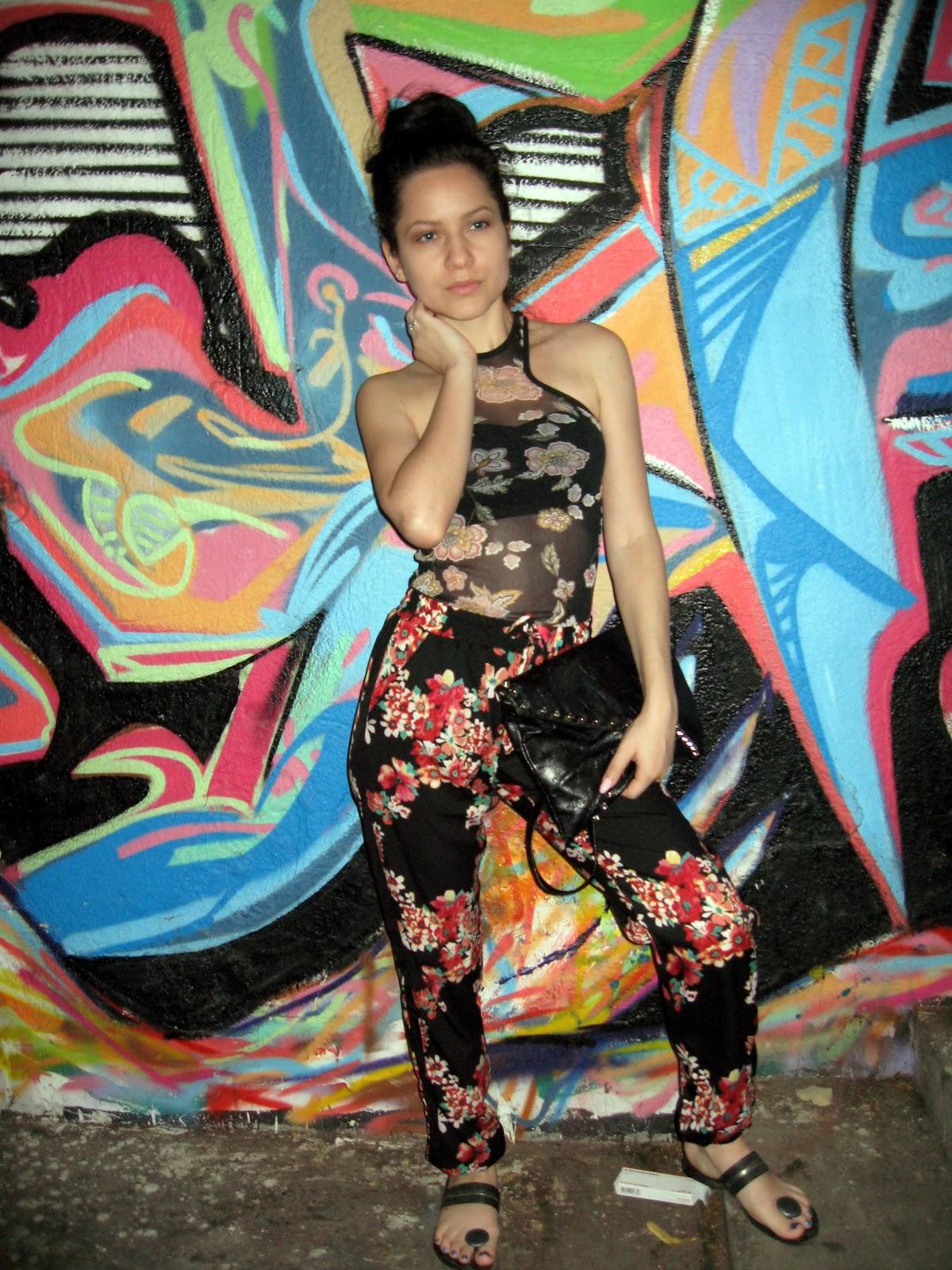 terranova sheer floral tank top, terranova floral pants, black flip flops, black studded clutch, messy bun, casual look, street graffiti art