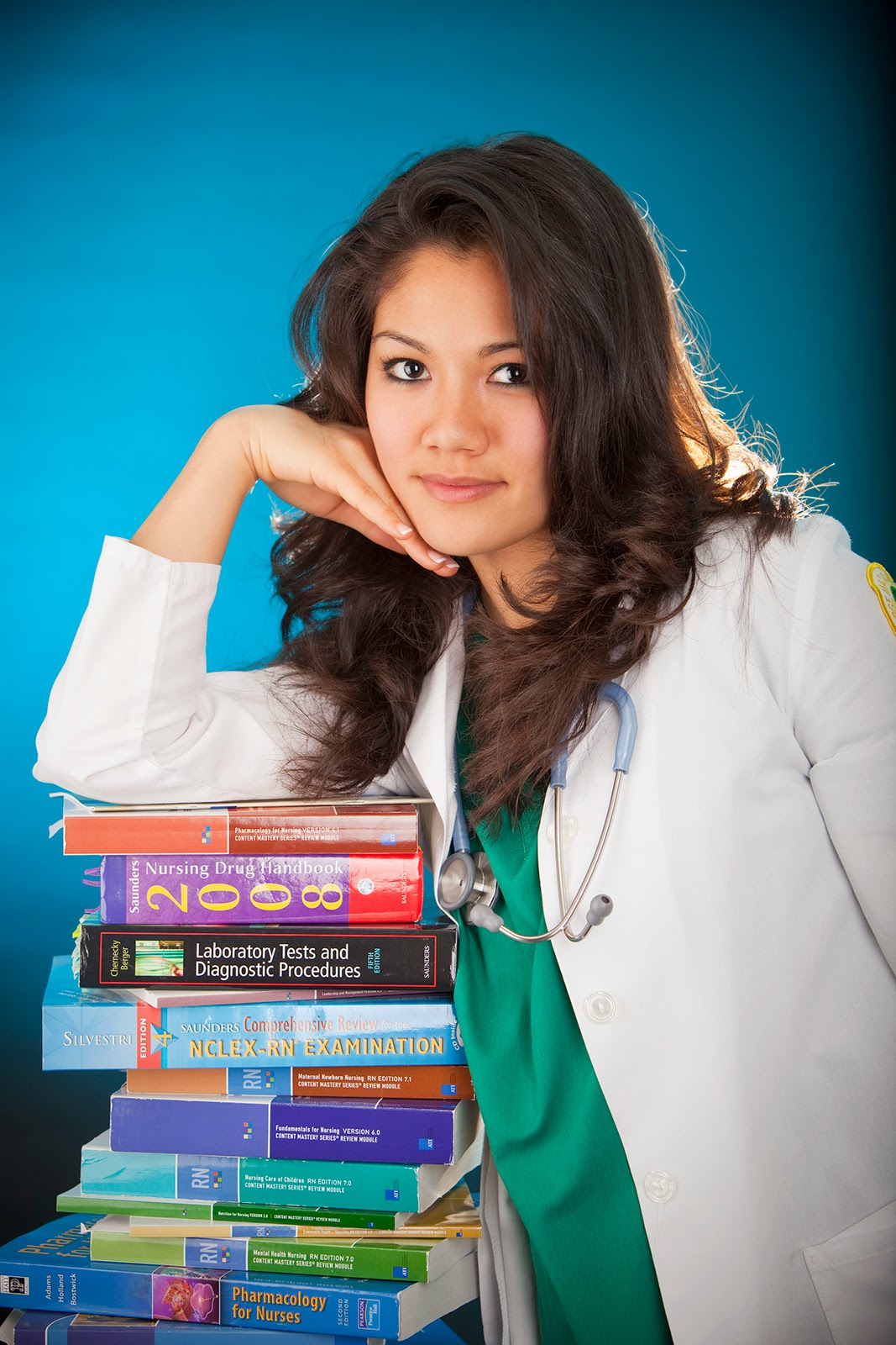 College books stacked up with nurse