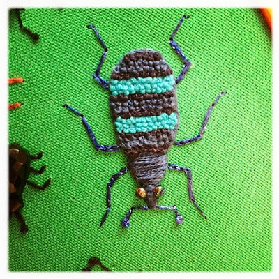 Broderi. Stumpwork Weevil beetle. French knots, padded satin stitch.
