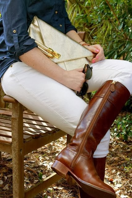 Fashionable Brown Leather Long Boots with White Jeans, Navy Blue Shirt and Golden Clutch Bag, Amazing Combination for Fall and Winter