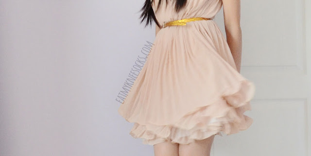 SheIn's apricot shift dress features a romantic ruffled multilayer hem, with a pleated bodice and a cute vibe.