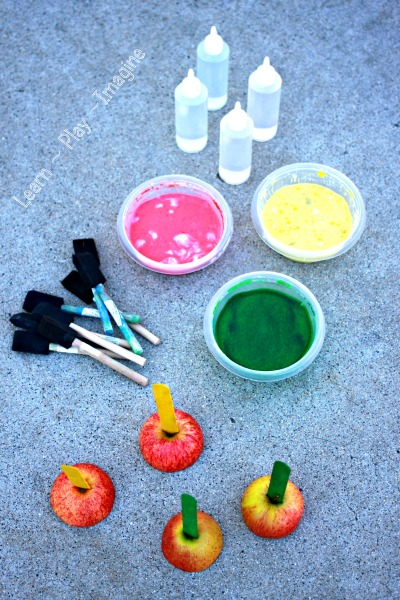 Invitation to make apple prints with sidewalk chalk, and they erupt!