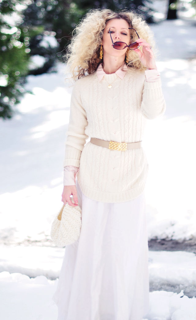 big blonde afro curls, light neutrals in the snow, winter style