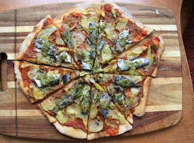 thin crust pizza with pesto roasted sardines and slivered potatoes