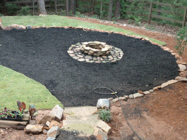 Tiki rancher weekend progress sod mulch sore muscles for Gravel around fire pit