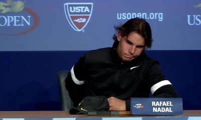 Rafael Nadal press conference US Open day two round one black white jacket grimace screencaps images photos pictures