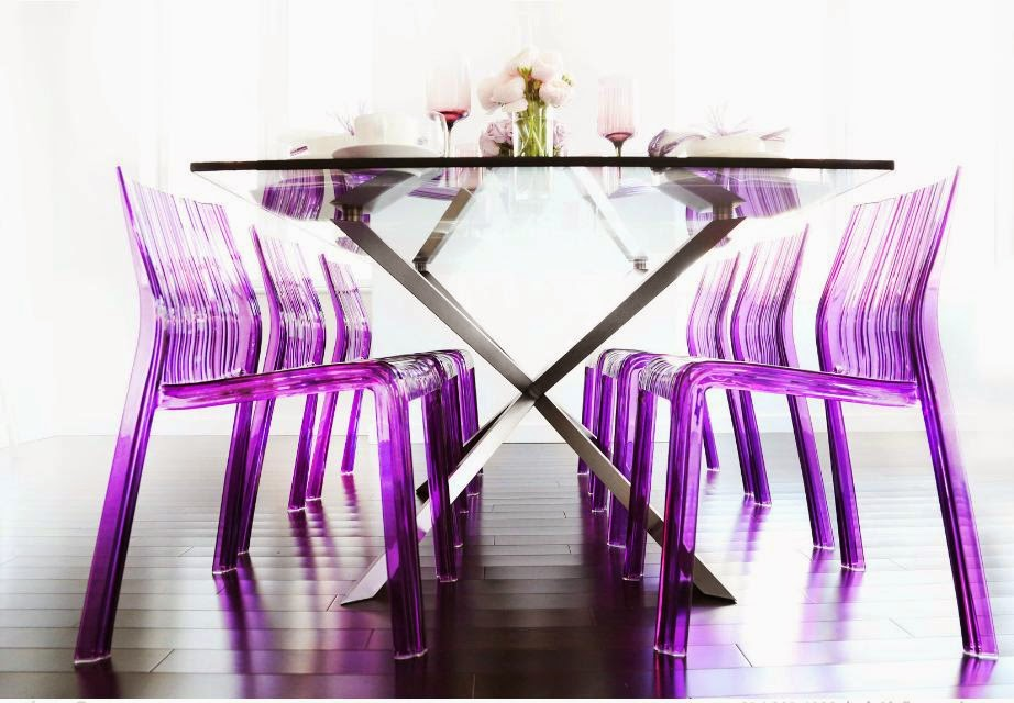 Modern fuchsia lucite chairs and dining table with metal legs