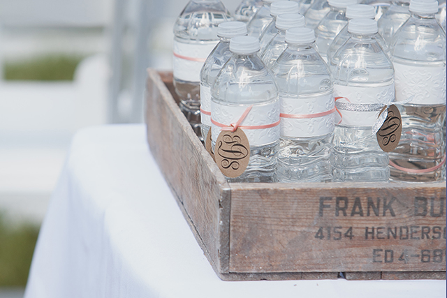 Monogramed water bottles in vintage crates.