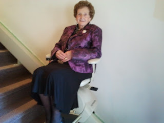 Mary McMaster, riding the new chair lift at Omemee Baptist  Church