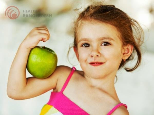 A baby girl with apple