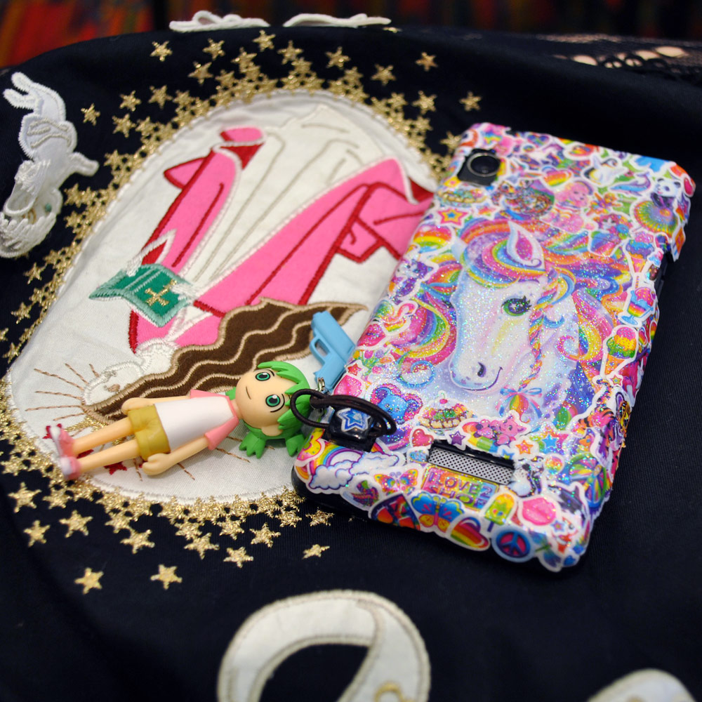 My Lisa Frank phone case, Yotsuba cell strap, and Baby the Stars Shine Bright dress!
