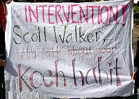banner on a sheet saying, This is an intervention Scott Walker.  Let's talk about your Koch habit.