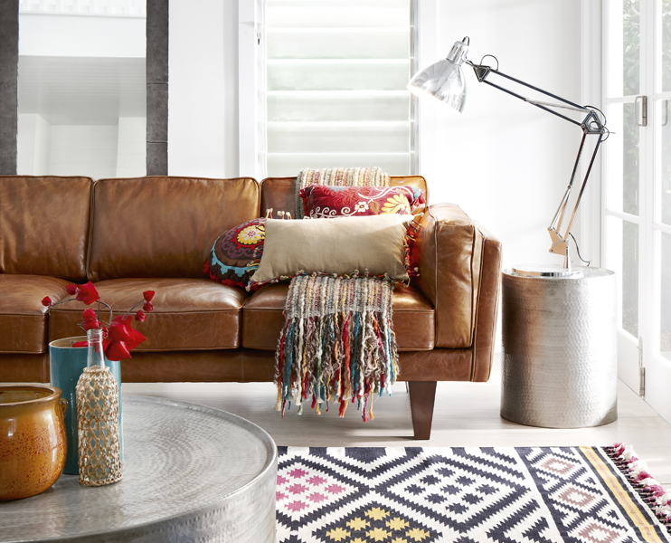 Living room with leather sofa and modern silver sidetable